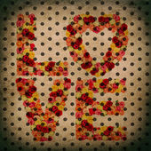 LOVE letters over old fashioned polka dot wallpaper — Stockfoto