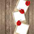 Three old photo frames with red hearts petals — Stockfoto