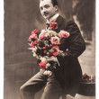 Young man with rose flowers. vintage photo — Stock Photo #41726225