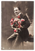 Young man with rose flowers. vintage photo — Stock Photo
