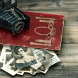 Vintage camera and album with old photos. nostalgia — Stock Photo