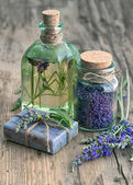 Lavender oil, herbal soap and bath salt with flowers — Stock Photo