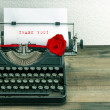 Vintage typewriter with paper page and rose flower — Stock Photo #42140543