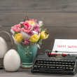 Easter still life with tulips, eggs and typewriter — Stock Photo #42957337