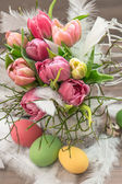 Easter decoration with tulip flowers and eggs — Stock Photo