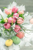 Easter eggs and tulips with water drops — Stock Photo
