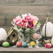 Easter stillife. tulip flowers and colored eggs — Stock Photo #43502593