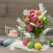 Tulip flowers with colored easter eggs — Stock Photo #43505521
