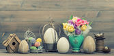 Easter stillife. Tulip flowers and colored eggs — Stock Photo