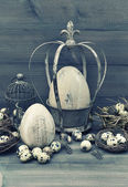 Easter decoration with eggs, nest and birdcage — Stock Photo