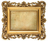 Baroque style golden picture frame with canvas — Stock Photo