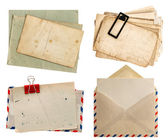 Envelope air mail and postcards isolated on white — Stock fotografie