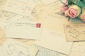Vintage postcards and soft rose flowers. nostalgia — Stock Photo