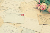 Vintage postcards and soft rose flowers. nostalgia — Stock Photo