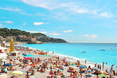 People relaxing on the public beach in Nice — Stock Photo