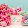Tulip flowers and pastel colored easter eggs — Stock Photo
