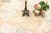 Roses, french postcards and souvenir Eiffel Tower Paris — Stock Photo