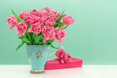 Pink tulip flowers and gift box — Stock Photo
