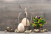 Easter decoration with eggs and pansy flowers — Stock Photo