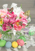 Pink tulip flowers, easter eggs, butterflies — Stock Photo