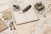 Open notebook, old letters and accessories — Stock Photo