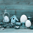 Vintage easter decoration with eggs, nest and birdcage — Stock Photo