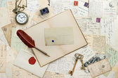 Notebook, writing accessories and postcards — Stock Photo