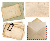 Envelope air mail and postcards isolated on white — Stock Photo