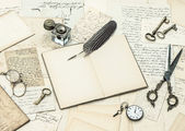 Open journal, old handwritings and postcards — Stock Photo