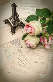 Roses, antique french postcards and souvenir — Stock Photo