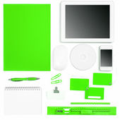 Set of green colored office tools over white — Stock Photo