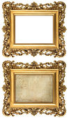 Baroque style golden picture frame empty and with canvas — Stock Photo
