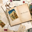 Old postcards, letters, mails and open travel book — Stock Photo