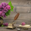 Still life with lilac flowers and antique items — Stock Photo