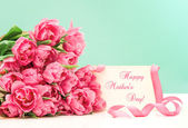 Pink tulips and greeting card — Stock Photo