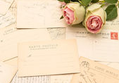 Vintage postcards and rose flowers. old love letters — Stock Photo