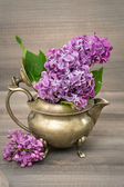 Lilac flowers in antique vase — 图库照片