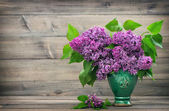 Bouquet of lilac flowers in vase — Stock Photo