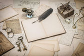 Open diary book, old letters, office supplies — Stock Photo