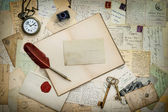 Book, antique writing accessories and postcards — Stock Photo