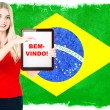 Young woman with flag of brasil and tablet pc — Stock Photo #49305007