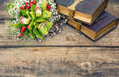 Old books and orchid flowers — Stock Photo