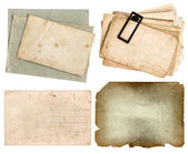 Aged papers and postcards isolated on white background — Stock Photo