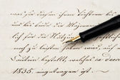 Calligraphic handwritten text and vintage ink pen — Stock Photo