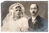 Vintage wedding photo. funny just married couple — Stock Photo