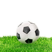 Soccer ball on green grass over white — Stock Photo