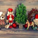 Christmas decoration with antique toys teddy bear and nutcracker — Stock Photo #49571519