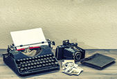 Antique typewriter and vintage photo camera — Stock Photo