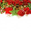 Baubles, golden garlands, christmas tree and red berries — Stock Photo #50326435