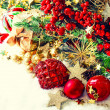 Baubles, golden garlands, christmas tree and red berries — Stock Photo #50326473